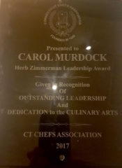 Carol A. Murdock was presented with the Herb Zimmerman Leadership Award by the CT Chefs Association at their February meeting. Facebook image.