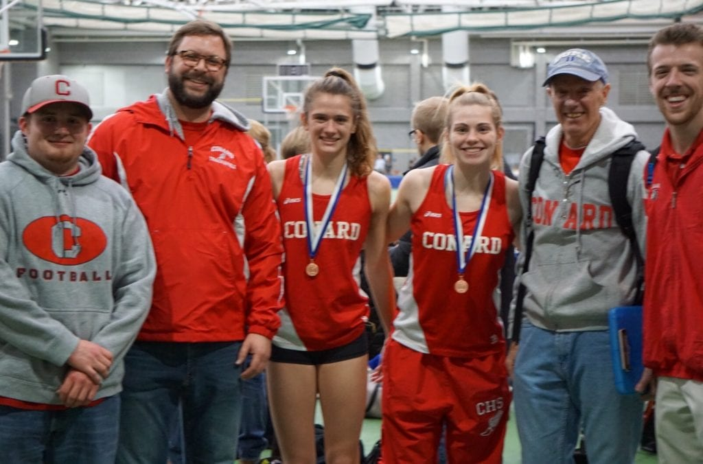 Conard track and field coaches and New England Championship-qualifying athletes (from left): James Redman, head coach John Provencher, Libby McMahon (300m), Gwen Geisler (1600m), Steve Chase, and Matt DeMarco. Photo credit: Linda Geisler