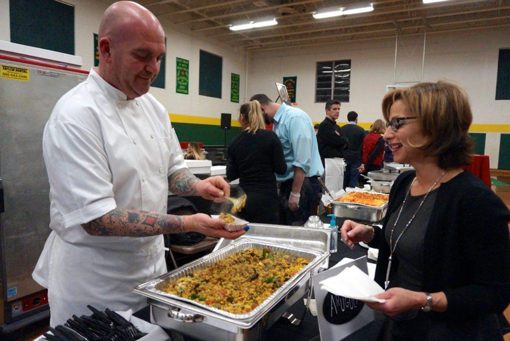 West Hartford Mayor Shari Cantor samples Arugula's Israeli Couscous at the Fourth Annual Taste of Elmwood. Feb. 2, 2017. Photo credit: Ronni Newton