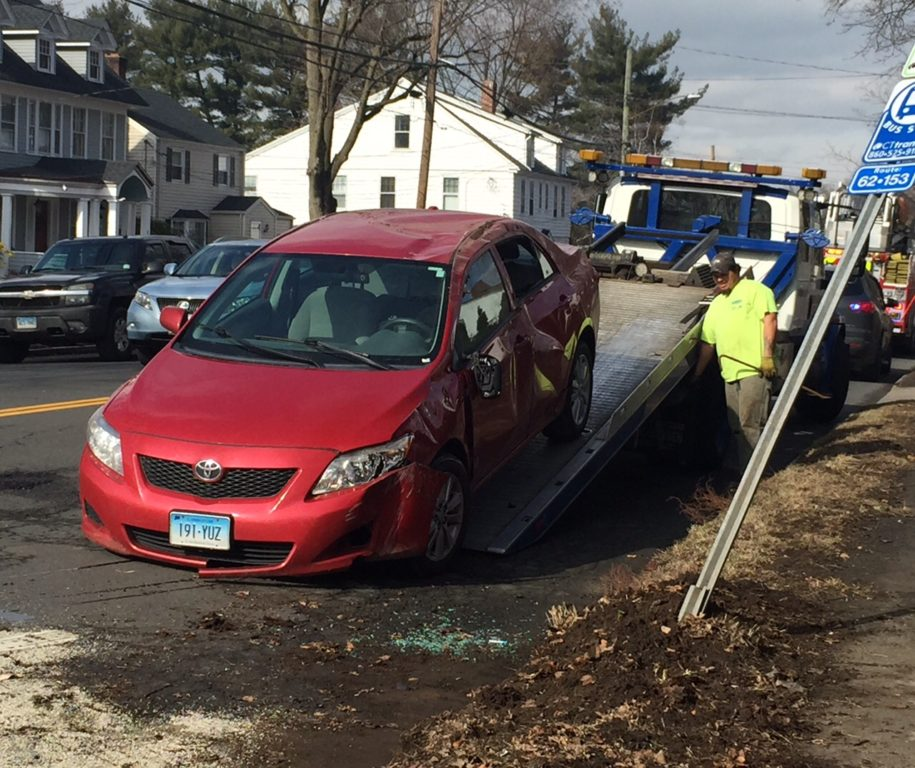 A Toyota Corolla, driven by a West Hartford man, rolled over on North Main Street on Wednesday after being hit by a suspect driving a stolen car and fleeing Hartford Police. Photo credit: Ronni Newton
