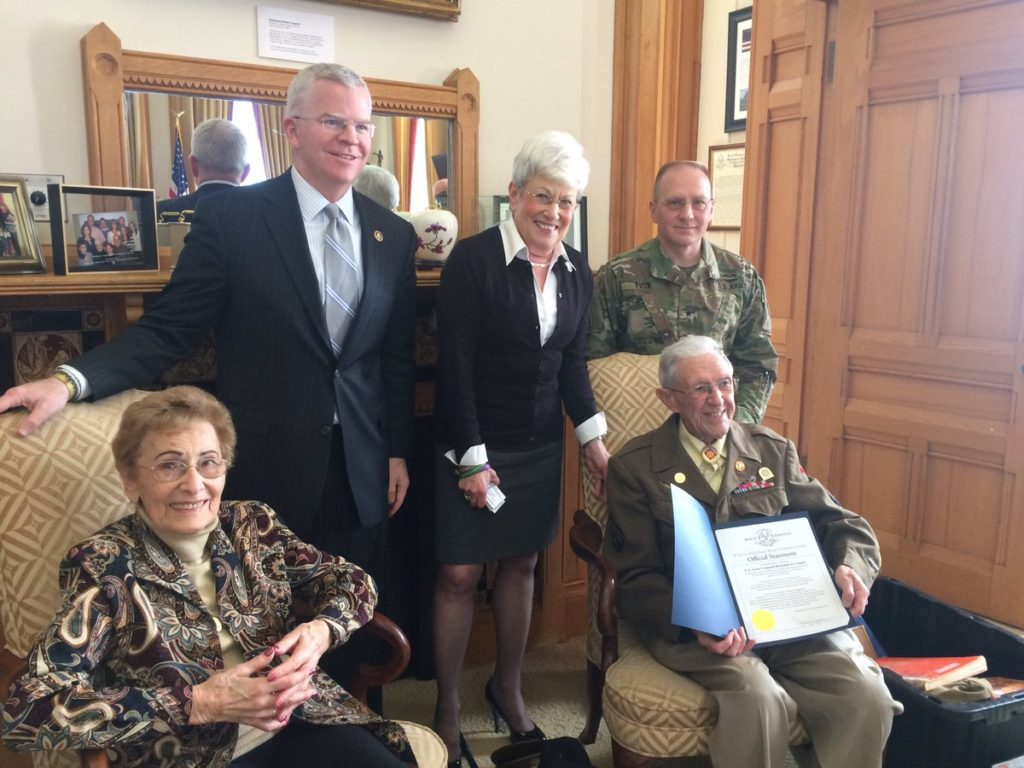 WWII veteran Benjamin Cooper of West Hartford (seated) receives a citation from Lt. Gov. Nancy Wyman, Department of Veterans Affairs Commissioner Sean Connolly (left), and Assistant Adjutant General of the Connecticut National Guard Brigadier General Francis Evon (right). Seated is Holocaust survivor Henny Markiewicz Simon of Colchester. Courtesy photo