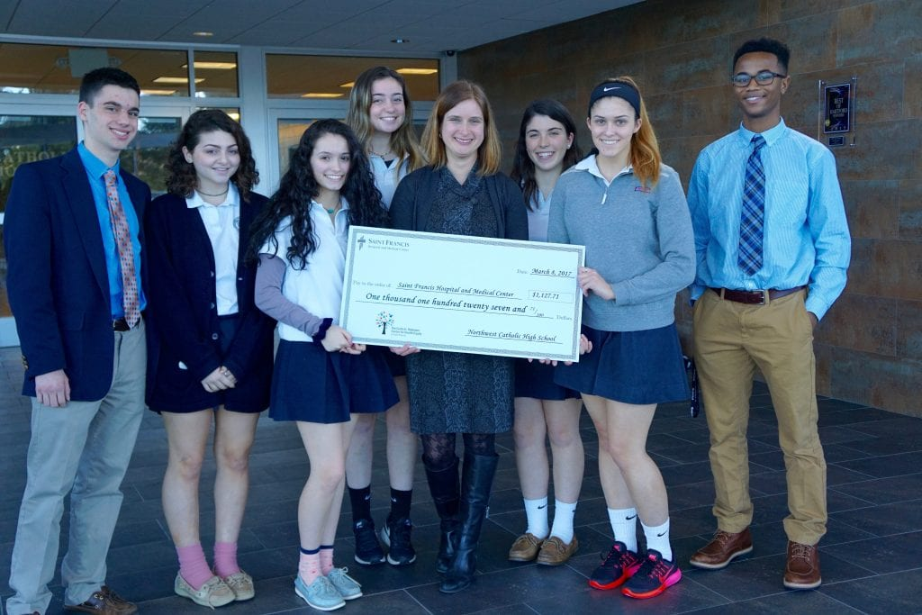 Students from Northwest Catholic present check for $1,127.71 to Amy Griffin Buzzell, Director of Operations for the Saint Francis Foundation, to benefit The Curtis D. Robinson Center for Health Equity at Saint Francis Hospital. Submitted photo