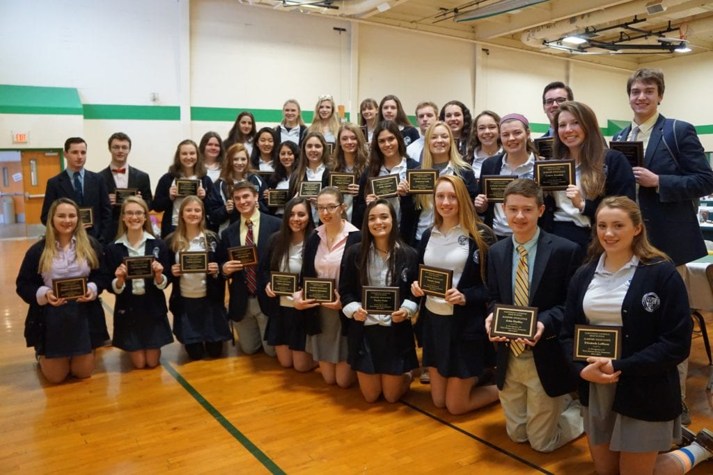 Northwest Catholic High School seniors proudly display their plaques earned by achieving First Honors every semester since they began as freshmen. Pictured: Brett Baker, Leanna Beaulieu, Rachel Conover, Kamryn Desrosiers, Gabriela Doskos, John Dudley, Veronica Eskander, Abigail Flower, Kelly Galeota, Brendan Gill, Christina Gluch, Katharine Jessen, Sarah Jessen, Maeve Kearns, Katelyn Konigsberg, Laura Kunkel, Elizabeth LeBlanc, Francesca Link, Joseph Morelli, Katherine Mullen, Claire Nicholas, Kennedy O'Hara, Emilia Palascak, Taylor Pane, Ellen Paradise, Theadora Petropoulos, Christopher Poniatowski, Valeria Seymour, Natalie Smith, Joshua Vallera, Shane Walsh, Mary Wood, Angel Zohrabian. Not pictured: John Allen, Brynna Ledwidge, Allyson Voelker. Submitted photo