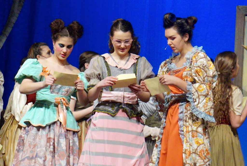 From left: Charlotte, Gabrielle, and the wicked Madame receive their ball invitations. Conard High School Musical Productions presents 'Cinderella.' Photo credit: Ronni Newton