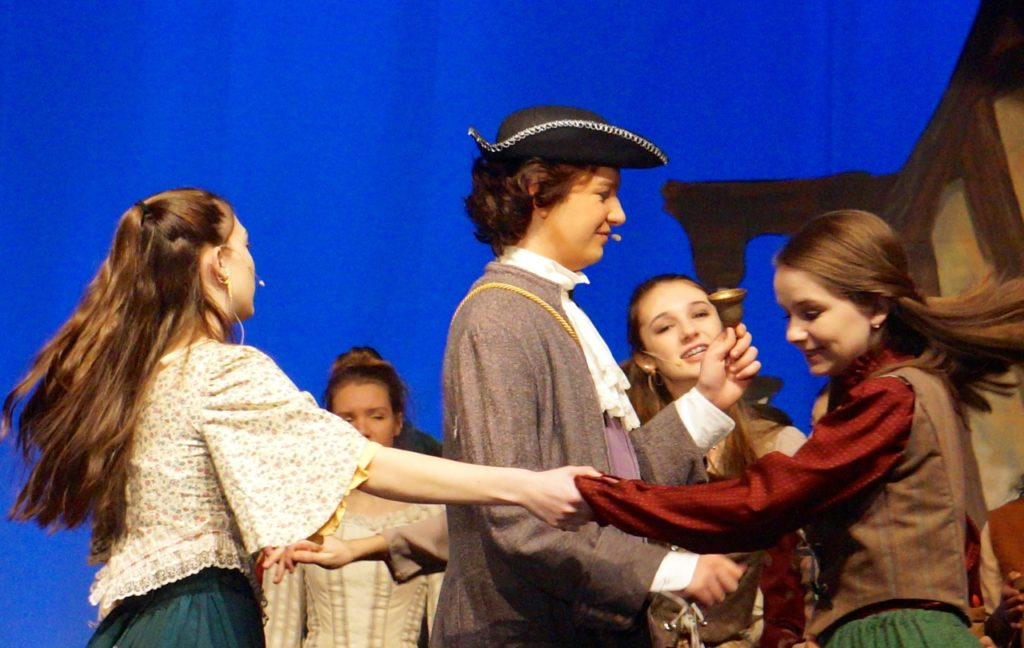 The townspeople show their excitement about the ball invitation by dancing around Lord Pinkerton. Conard High School Musical Productions presents 'Cinderella.' Photo credit: Ronni Newton