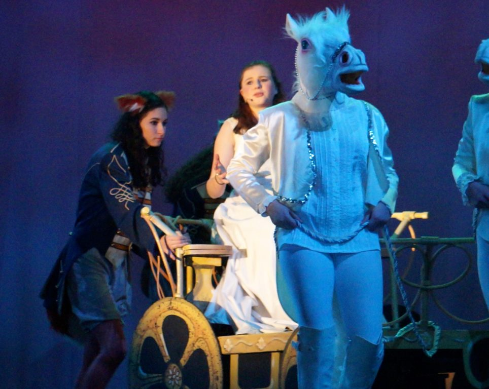 Following her transformation by Crazy Marie, Ella is whisked off to the ball in her carriage (former pumpkin) pulled by mice-turned-horses and escorted by a former fox and raccoon. Conard High School Musical Productions presents 'Cinderella.' Photo credit: Ronni Newton
