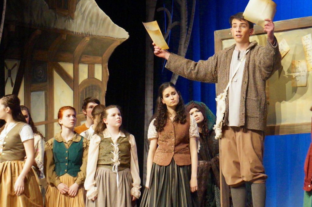 Jean-Michel, the revolutionary student, tries to explain what's happening in the kingdom to the townspeople. Conard High School Musical Productions presents 'Cinderella.' Photo credit: Ronni Newton