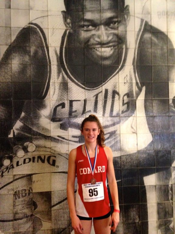 Libby McMahon in front of a mural of the arena's namesake – Reggie Lewis. Photo courtesy of Christine McMahon