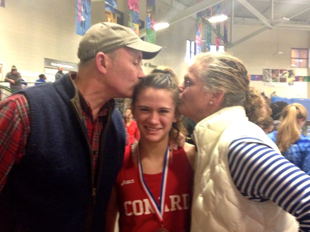 Libby McMahon's parents embarrass her with a kiss after the race. Photo courtesy of Christine McMahon