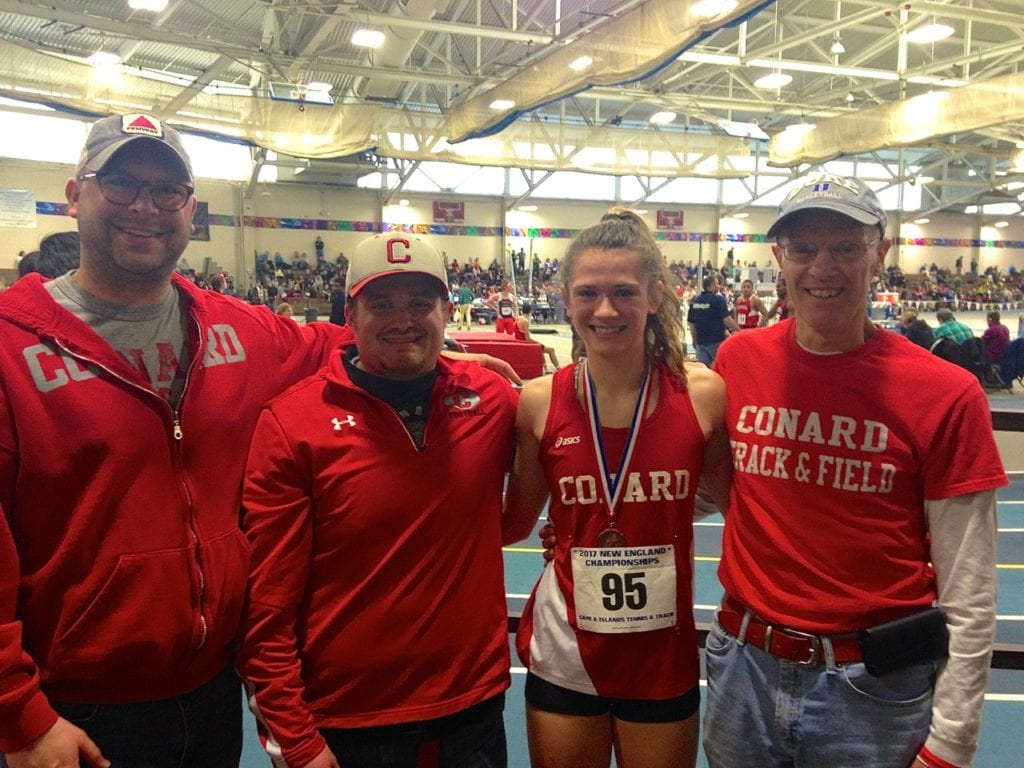 Libby McMahon with her dedicated coaches at the New England Championships. From left: Head coach John Provencher, James Redman, McMahon, and Stephen Chase. Photo courtesy of Christine McMahon