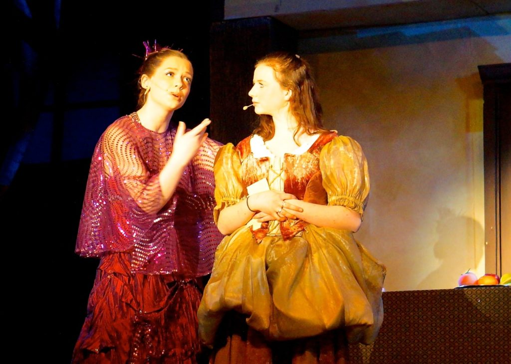 Crazy Marie, the fairy godmother character, gives Ella instruction and encourages her. Conard High School Musical Productions presents 'Cinderella.' Photo credit: Ronni Newton