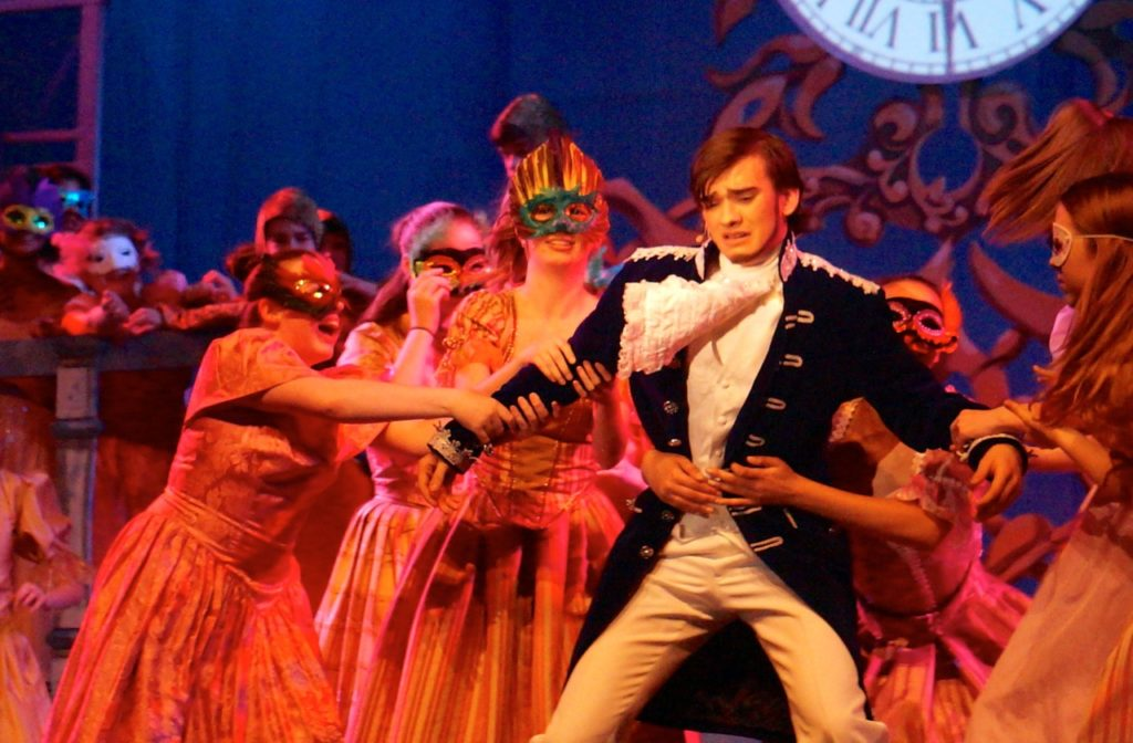 Prince Topher removes his mask and is revealed to the ball-goeres. Conard High School Musical Productions presents 'Cinderella.' Photo credit: Ronni Newton